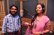 Raghu Kunche and Singer Malavika @ 'Nethra' Movie Songs Recording